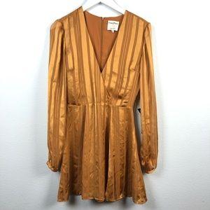 Privacy Please gold stripe surplice dress